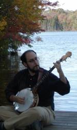 Ben Collins-Sussman playing the banjo by the water.